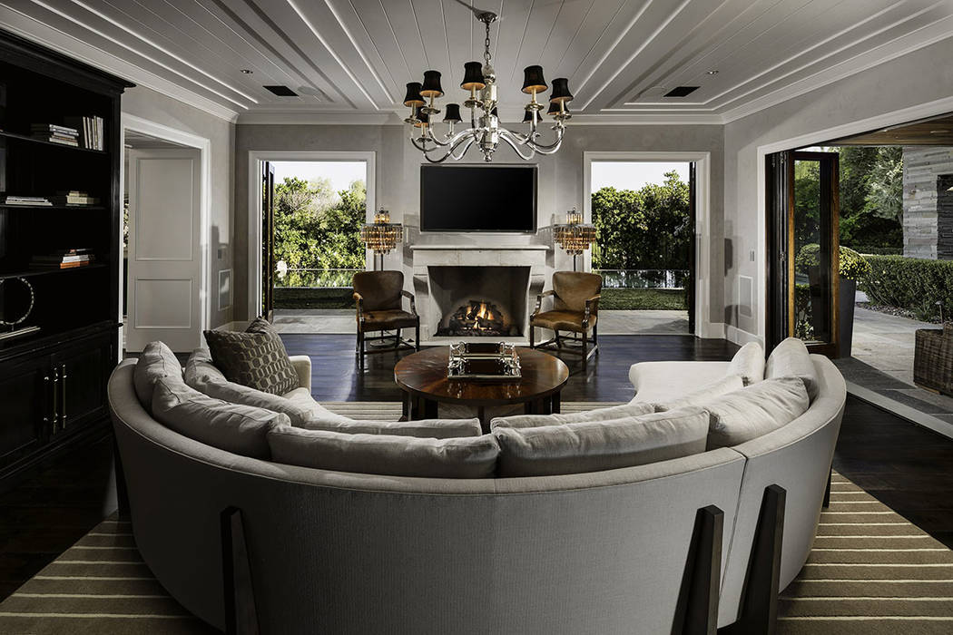 The Ridges home features a great room with a traditional fireplace. (Shapiro & Sher Group)