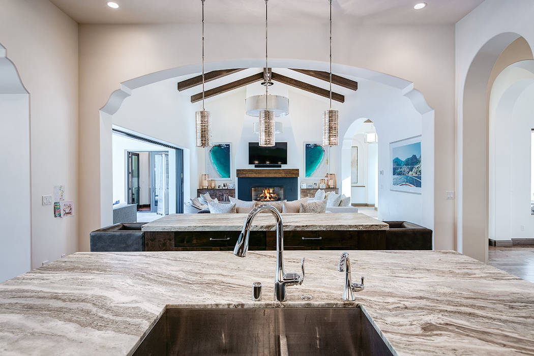This home in Southern Highlands features a great room connected to the kitchen. (Shapiro & Sher Group)