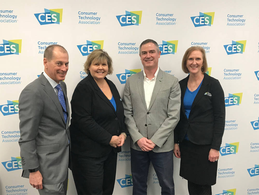 From left, Gary Shapiro, Glenda MacMullin and Karen Chupka of the Consumer Technology Association with Tom Kovach, second from right, executive director of the LVMPD Foundation.