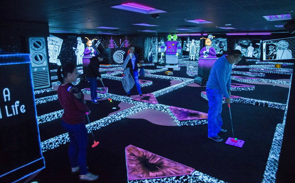 Golfers play at the new The Twilight Zone by Monster Mini Golf Dec. 6 at Bally's. (Benjamin Hager Las Vegas Business Press)