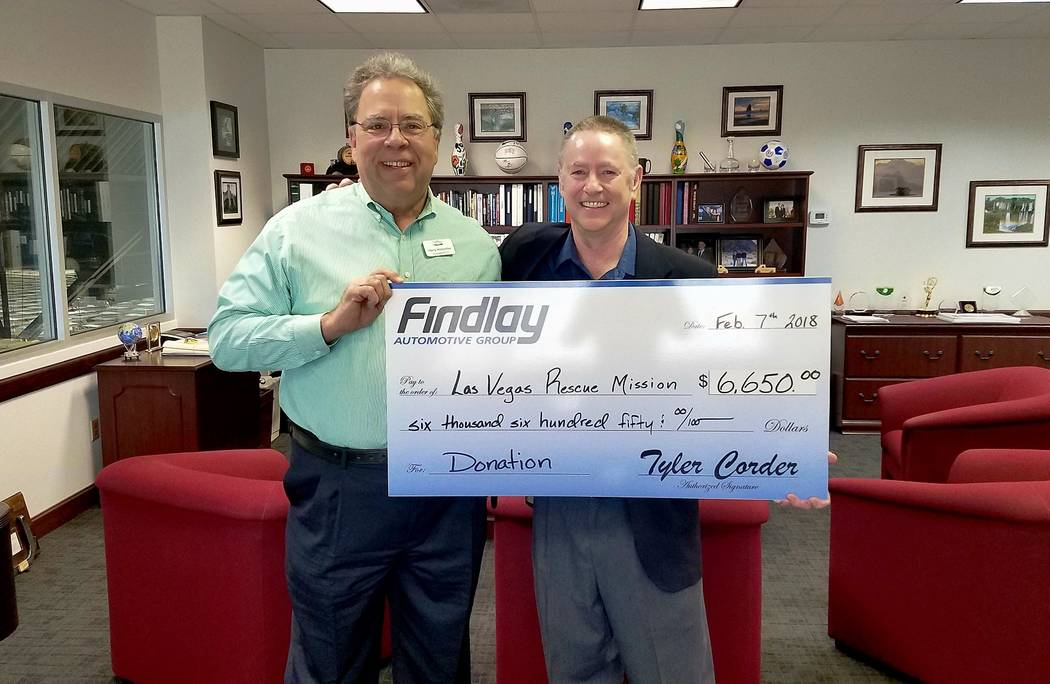 Findlay Automotive Group Chief Financial Officer Tyler Corder, right, presents a check to Harry Hinderliter, president and CEO of Las Vegas Rescue Mission.  (Findlay Automotive Group)