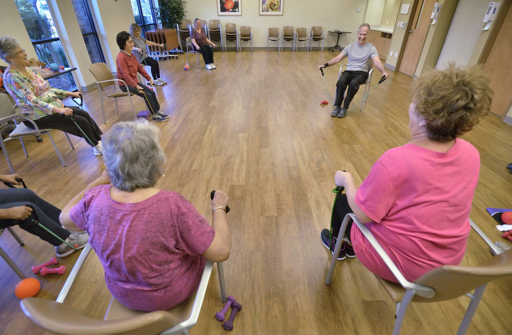 Instructor Bob Rose leads a SilverSneakers fitness class at the Southwest Medical Lifestyle Center West at  8670 W. Cheyenne Ave. on Jan. 29. (Bill Hughes Business of Medicine.)