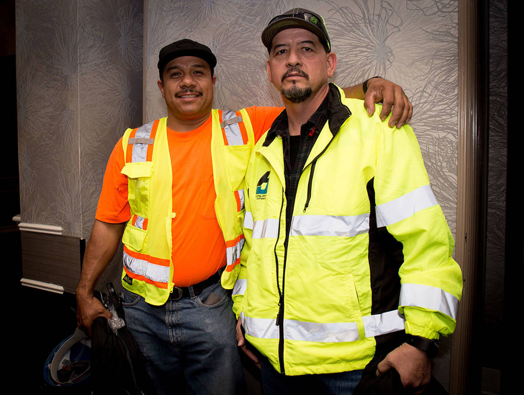 Abel Segovia and Ezequiel Marquez attend Penta Building Group's annual safety event. (Tonya Harvey Business Press)