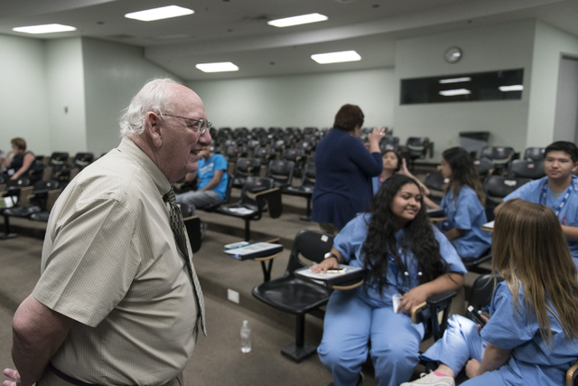 Dr. Willis K. Paull, professor of biomedical sciences with Roseman University of Health Sciences, speaks to students about neurology. (Jason Ogulnik Business of Medicine)