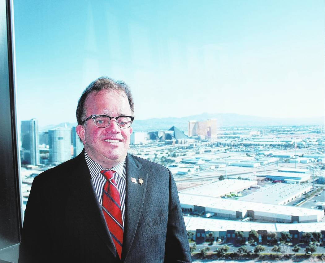 Christopher McGarey, team leader of McGarey Group at Berkshire Hathaway Home Services, Nevada Properties, stands at the top of the Palm Casino's Fantasy Tower, during the Southern Nevada Certified ...