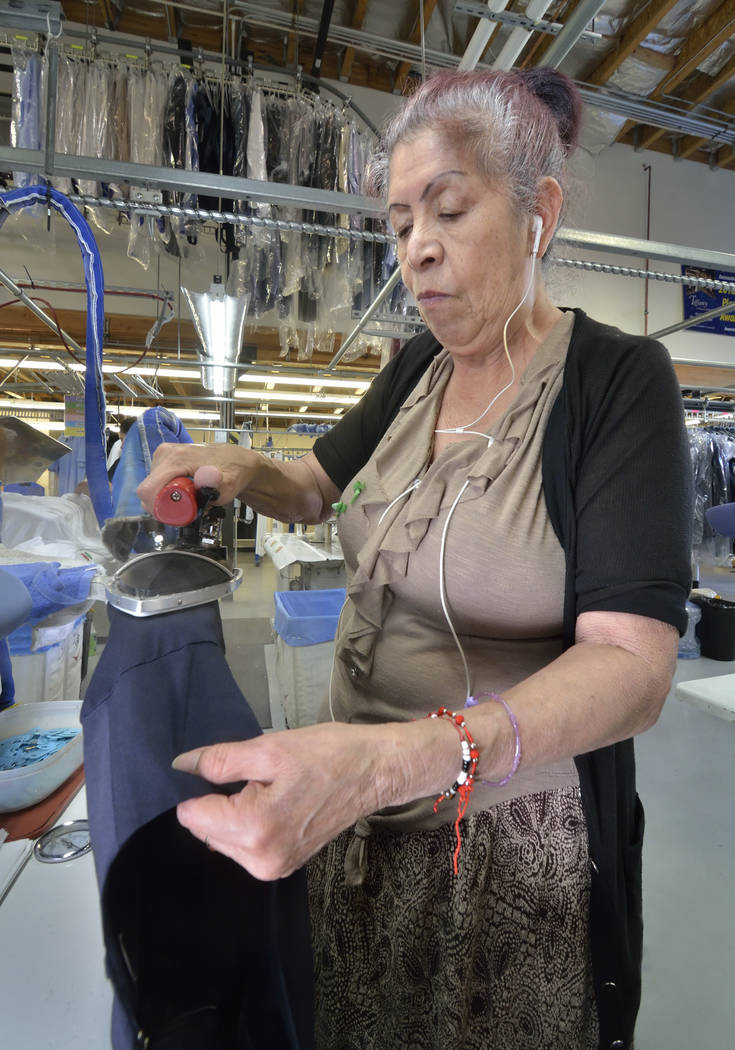 Silk presser Francesca Minjarez works in the cleaning and pressing area at Tiffany Couture Cleaners. (Bill Hughes Las Vegas Business Press)