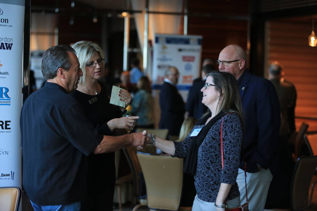 Lisa Chao, second from left, vice president of membership with the Henderson Chamber of Commerce, introduces Bill Wellman, Las Vegas Paving, left, to Barbra Coffee, center, director of economic de ...