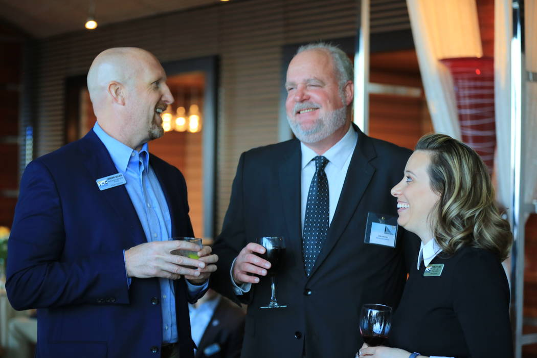 From left, Jeremy Golar, Retirement Benefits Group; John Harvey, Harvey Innovations; and Natalie Buckel, I Want My Two Dollars, talk during Insight, which was hosted by the Henderson Chamber of Co ...