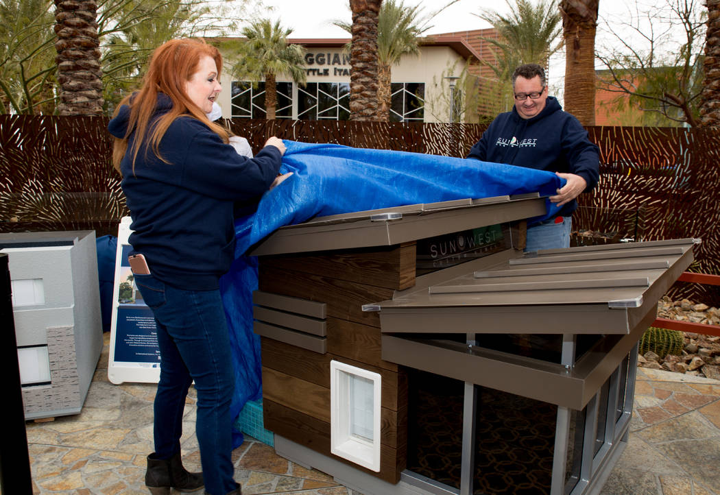 "Southwest Custom Homes designers Patty and Carl Martinez designers unveil their entry at the March 20 ""Barkitecture"" event. (Tonya Harvey Las Vegas Business Press)"