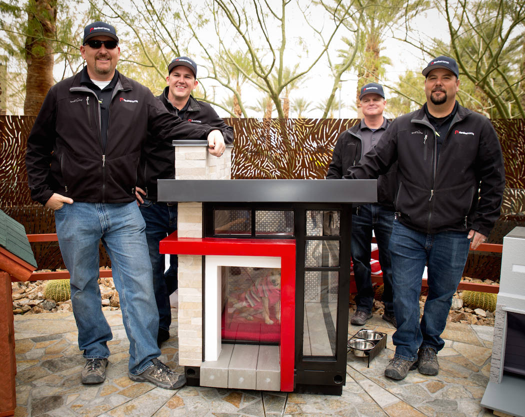 From left, Adam Gregg, Dustin Ellis, Kent Hall and Erich Pfaffinger of Pardee Homes pose with the doghouse they built to help raise money for HomeAid of Southern Nevada.