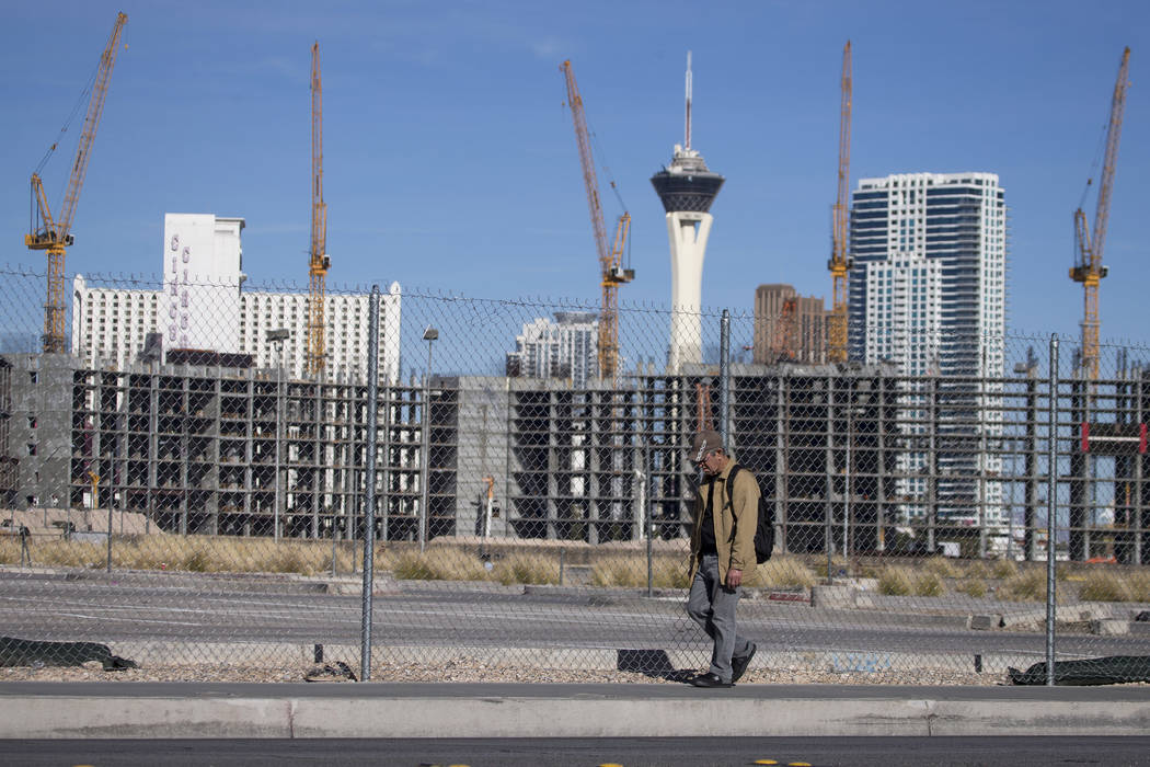 A man walks past the under-construction Resorts World Las Vegas project near the Strip on Jan. 14. (Richard Brian Las Vegas Business Press)