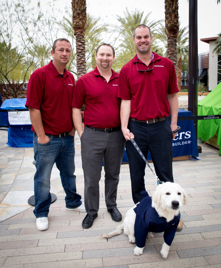 "From left, Dave Allen, Jason Willoby, Steve Caprio and his dog, Dunkin, represent Toll Brothers at the ""Barkitecture"" event March 20. Southern Nevada Home Builders Association members built doghou ..."