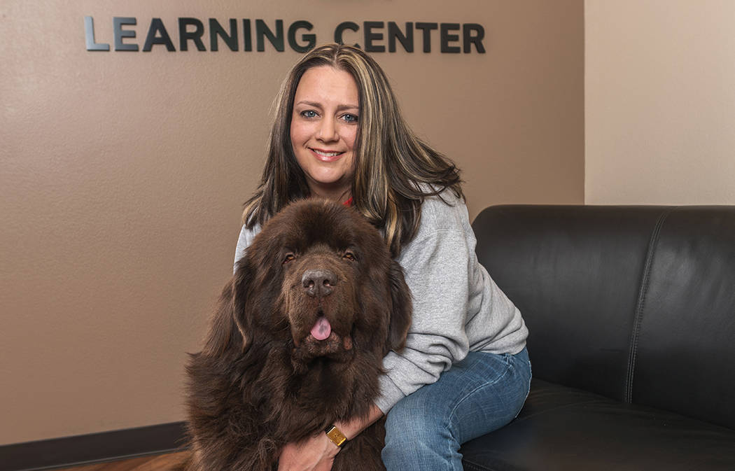 Emily Smith, executive director of the Nevada Blind Children's Foundation, with her dog, Buddy.