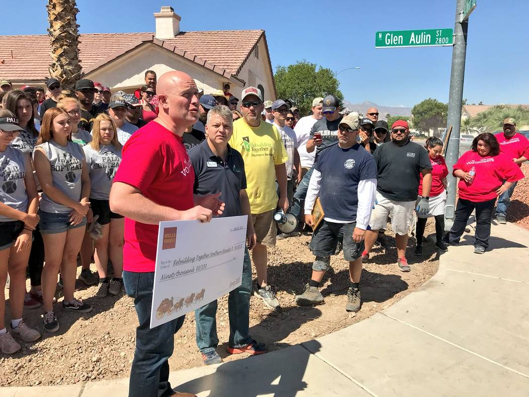 Wells Fargo Bank presented Rebuilding Together Southern Nevada a grant for $90,000 for affordable veteran housing in Las Vegas. Presenting the grant is Wells Fargo Nevada Southern Region Bank Pres ...