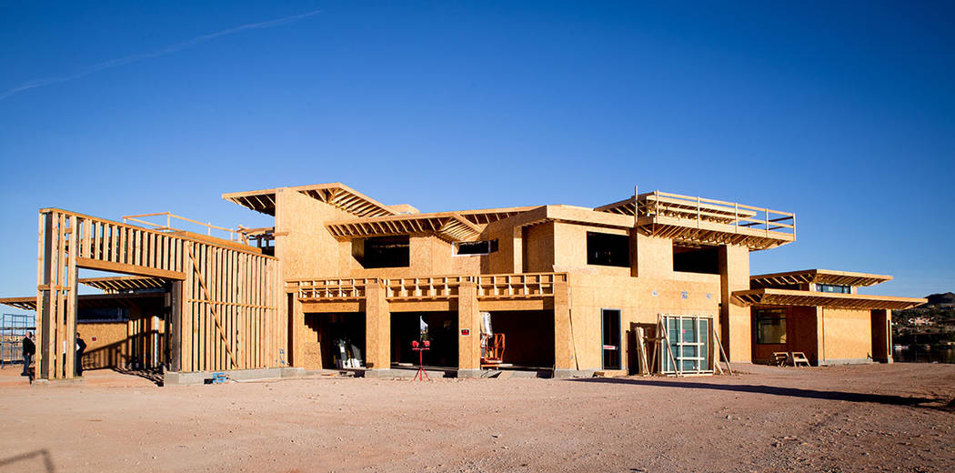 Construction is underway at the showcase home in the Estates at Reflection Bay in Lake Las Vegas. It is expected to open this fall. (Tonya Harvey Las Vegas Business Press)