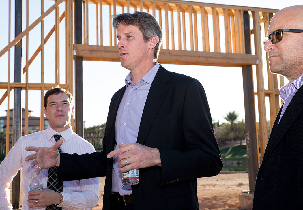 Architect Michael Wetzel, center, talks to and Kit Gallup, left, and Luxury Realtor Ivan Sher, right, about the showcase home under construction in Lake Las Vegas. (Tonya Harvey Las Vegas Business ...