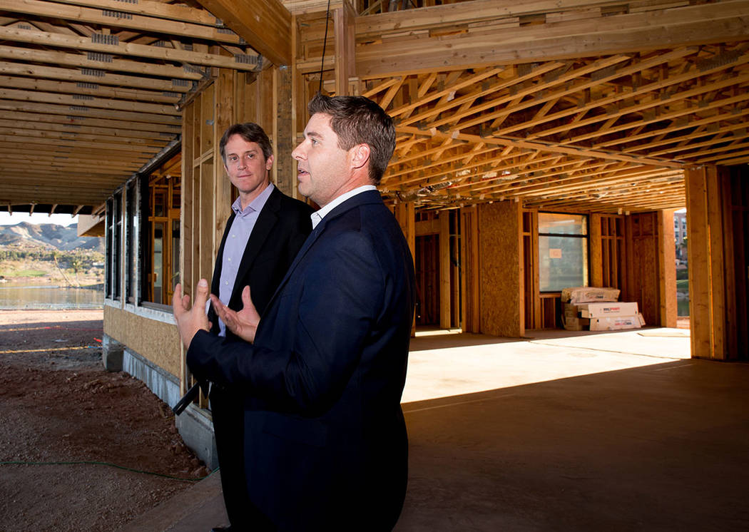 At right, Cody Winterton, Lake Las Vegas' senior vice president, talks to Michael Wetzel of Arizona-based Swaback Architects + Planners about the South Shore development. (Tonya Harvey Las Vegas ...