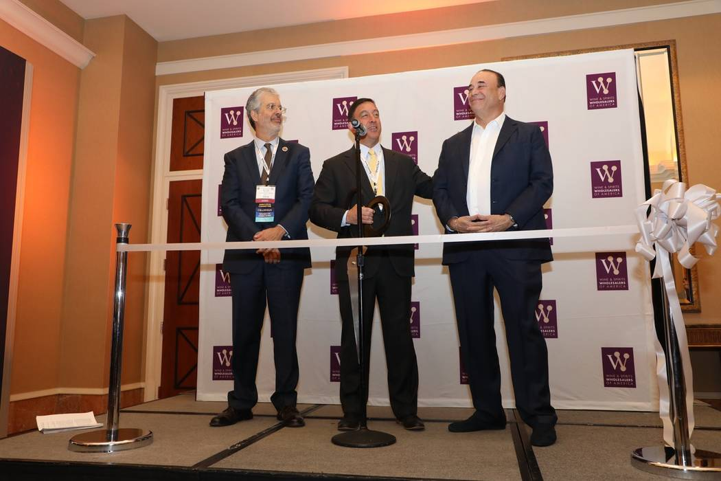 From left, Barkley Stuart, Southern Glazer's Wine & Spirits and incoming WSWA chairman; Craig Wolf, WSWA president and CEO; and Jon Taffer, Bar Rescue, kick off the Wine & Spirits Wholesalers of ...