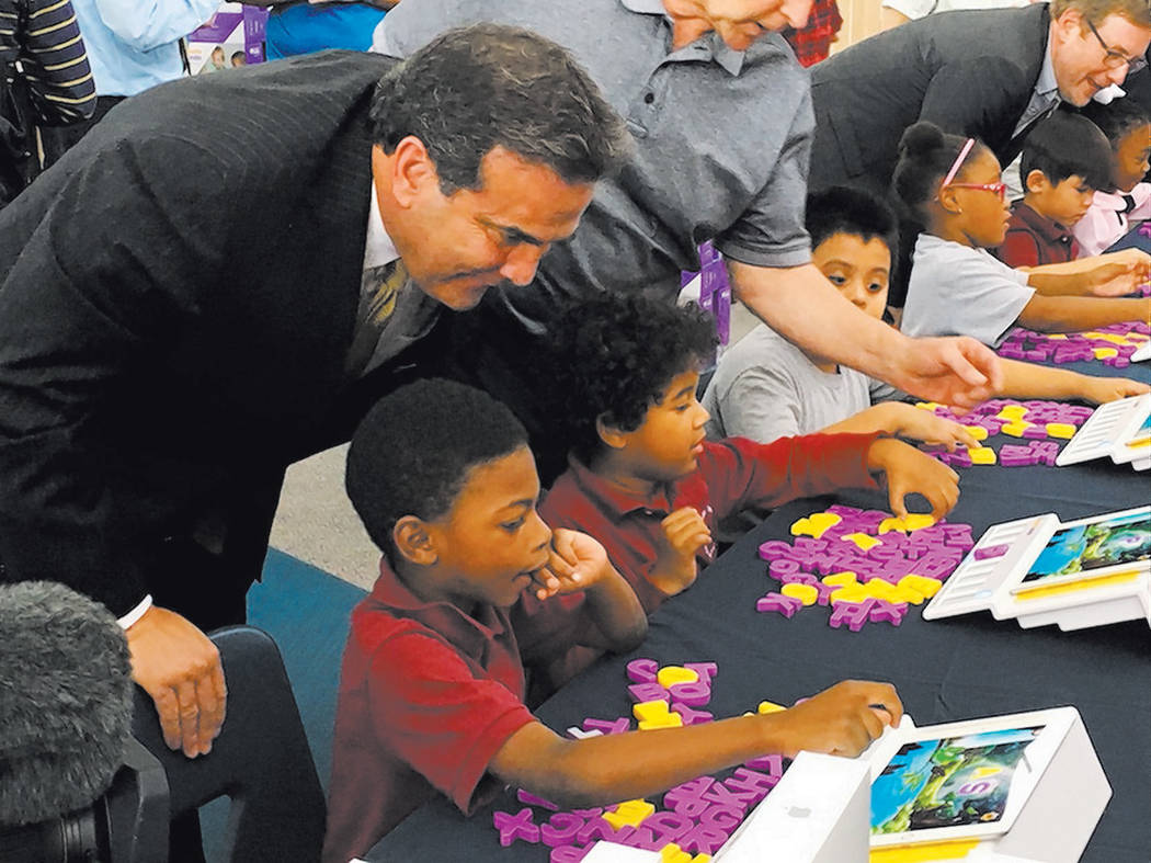 John Guedry, CEO, Bank of Nevada, talks to Las Vegas schoolchildren.