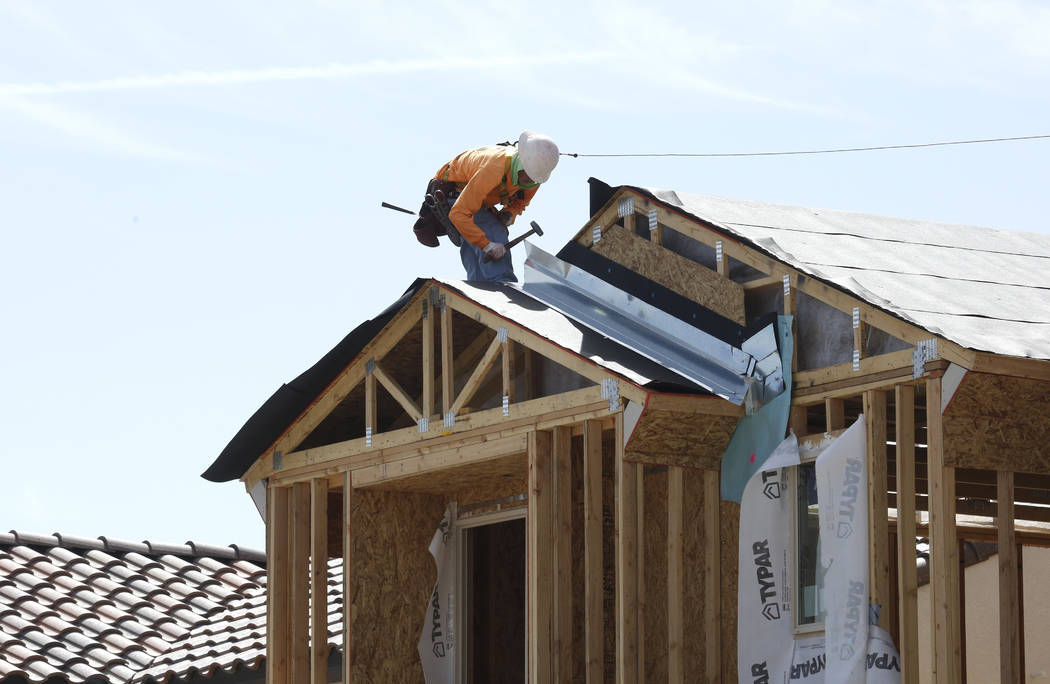 A construction worker puts a roof on a new home at the Cove at Southern Highlands and St. Rose parkways on April 18, 2018. (Bizuayehu Tesfaye Las Vegas Business Press)