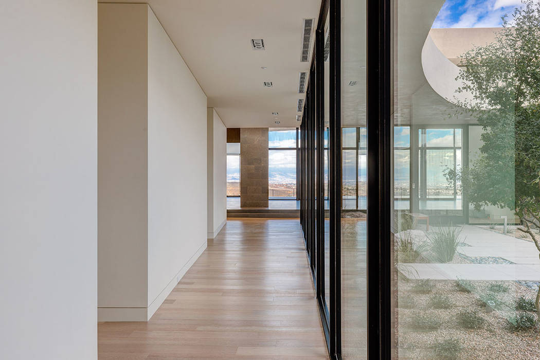 A hallway leads to the guests' quarters. (Hoogland Architecture)