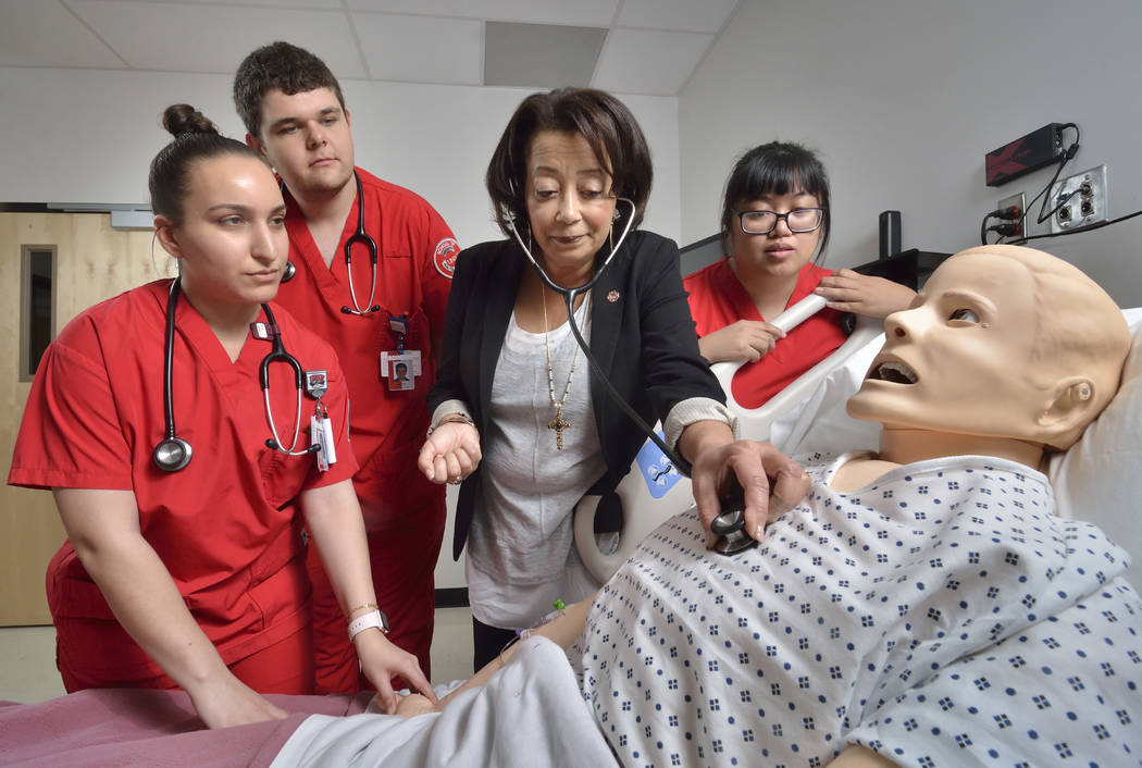 Angela Amar, dean of the UNLV School of Nursing, is shown with nursing students, from left, Ellen Sarkisian, Levi Gray and Fae Tahimick in the Clinical Simulation Center of Las Vegas at 1001 Shado ...