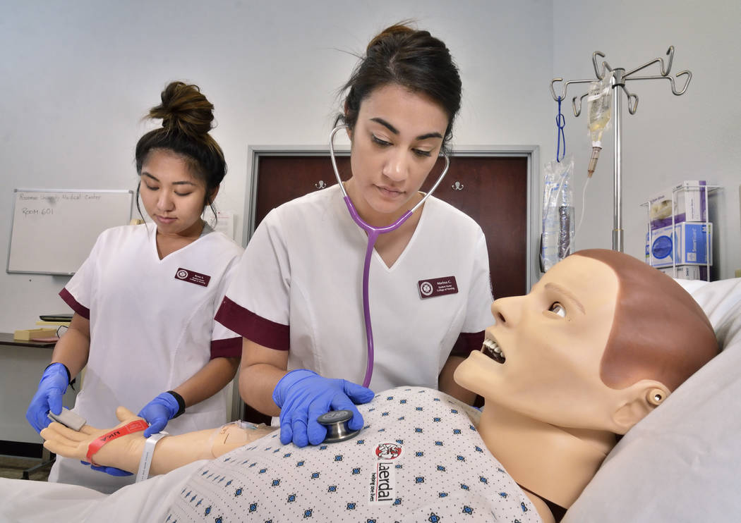 Nursing students Ryna Sagucio, left, and Marissa Cataldo work on a computerized mannequin at Roseman University of Health Sciences. (Bill Hughes Las Vegas Business Press)