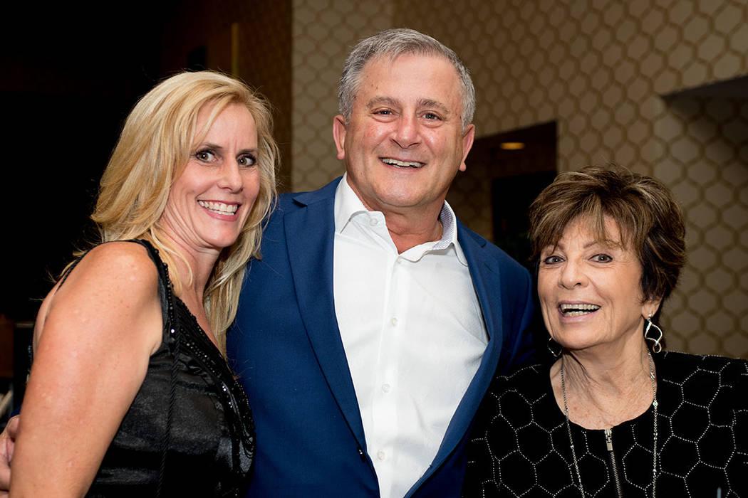 From left, Danna Hagenburger, Platinum Mortgage; and Joe and Dianne Ferraro, Closets Las Vegas. (Tonya Harvey Las Vegas Business Press)