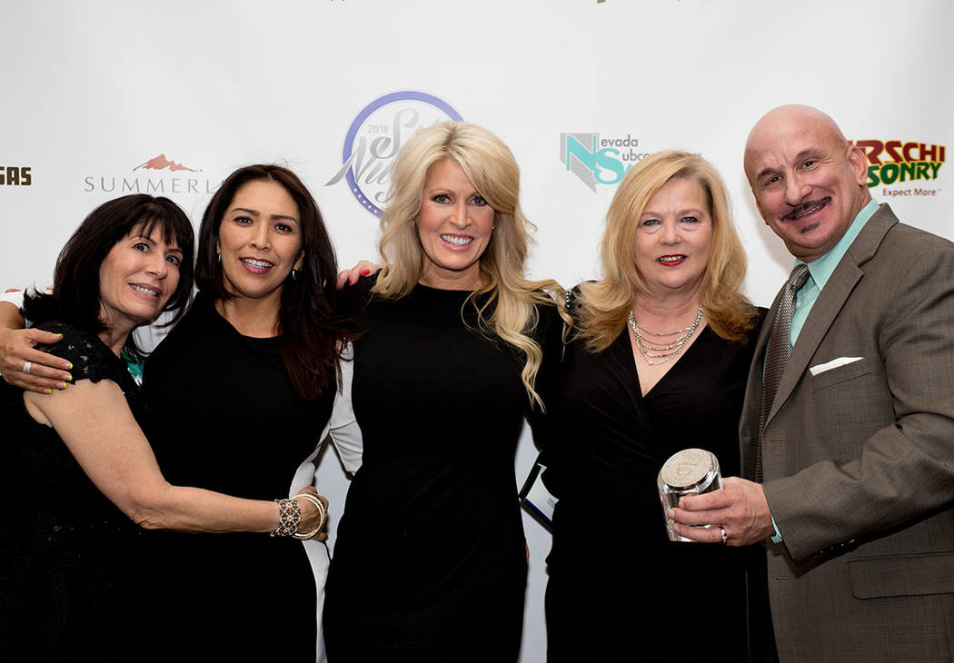 From left, Diane Paltrineri, Cynthia Cohen, Heather Kessler, Connie Lusk and Guy Melton of Woodside Homes. (Tonya Harvey Las Vegas Business Press)