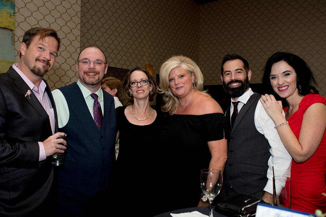 "From left, James ""JJ"" Kingery, Michael Owens, Janice Monteiro, Nicole Bloom, Adam and Allaina Morgan of Richmond American Homes. (Tonya Harvey Las Vegas Business Press)"