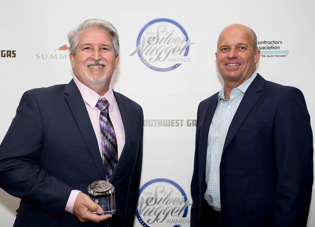 Larry Simon and Klif Andrews of Pardee Homes. (Tonya Harvey Las Vegas Business Press)