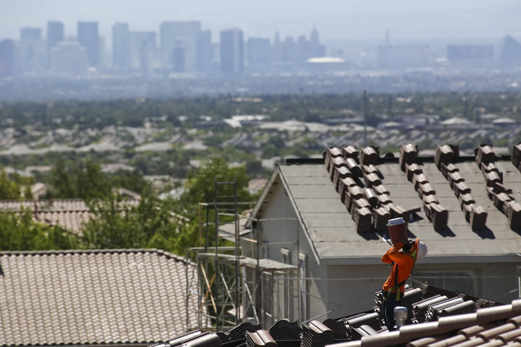 A roofer quenches his thirst while doing tile work on a house in the master-planned community of Summerlin. (Richard Brian Las Vegas Business Press)