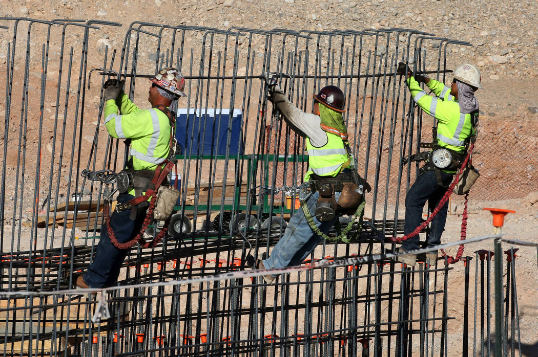 Workers tie rebar at the new Las Vegas ballpark construction site in Summerlin. (Bizuayehu Tesfaye Las Vegas Business Press)