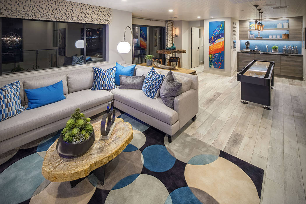 The family room leads to a balcony with views of the Las Vegas Strip. (Christopher Homes)
