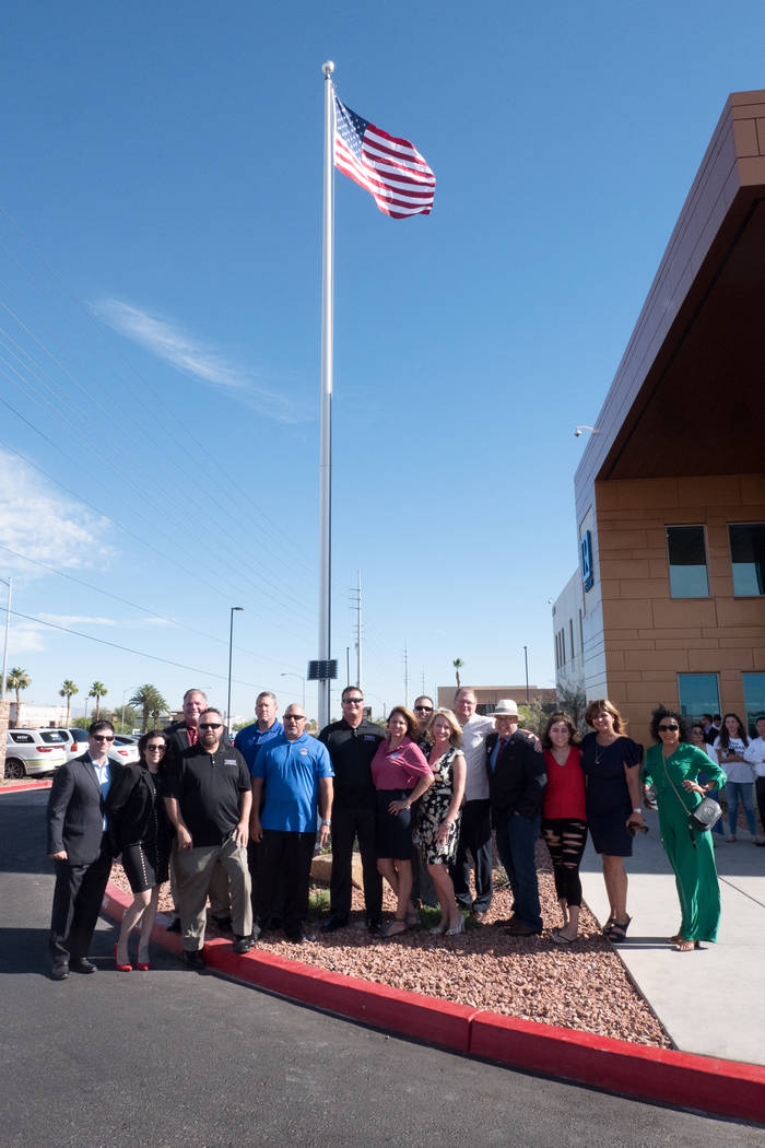 Members of the Greater Las Vegas Association of Realtors and Veterans Association of Real Estate Professionals President Ernie Gonzales gathered to raise the American flag for the first time over ...