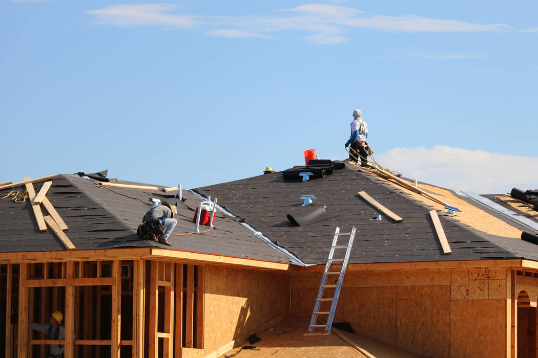 A construction crew works on a condominium project in Summerlin. (Madelyn Reese/Las Vegas Review-Journal)