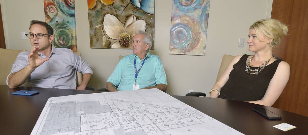 Mike Nigro, president of Nigro Construction, left, Mike Latalle, plant operations manager for Mountain's Edge Hospital, center, and Melissa War, CEO of the hospital, are shown during an intervie ...