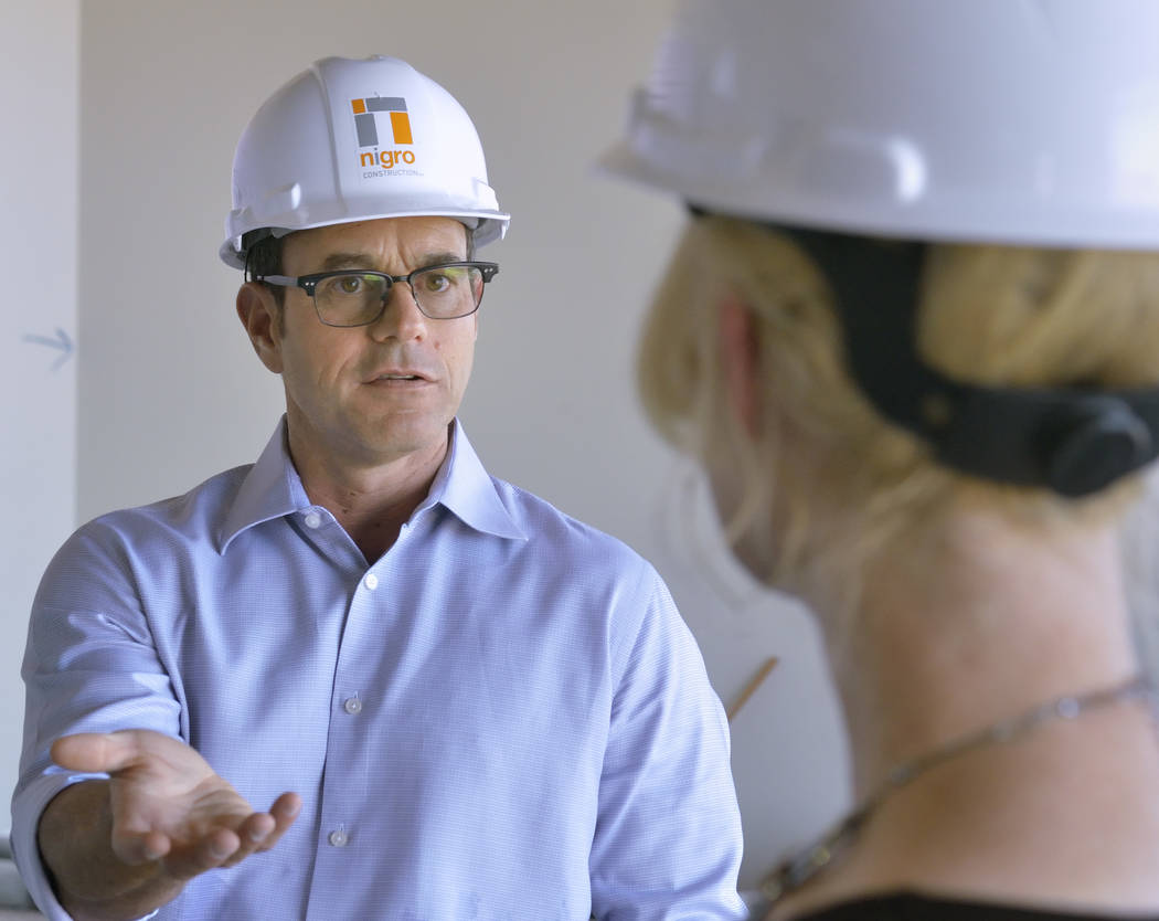 Mike Nigro, president of Nigro Construction, left, talks with Melissa War, CEO of Mountain's Edge Hospital, during a tour of the expansion to the hospital's orthopedic surgery center at 8656 W ...