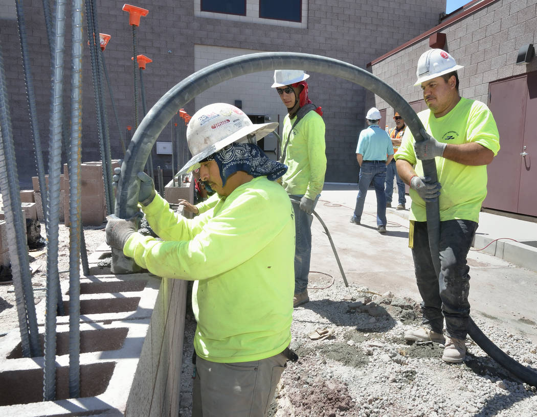 Workers pour concrete for a wall which is part of the expansion to the Mountain's Edge Hospital Orthopedic Surgery Center. (Bill Hughes Las Vegas Business Press)