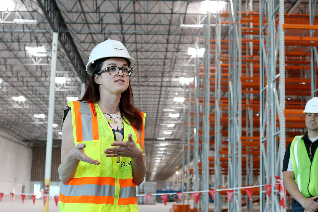 Amazon spokesperson Ashley Robison gives a tour of the newest Amazon warehouse that is under construction at Apex Industrial Park in North Las Vegas on March 27. (Elizabeth Brumley Las Vegas Busin ...