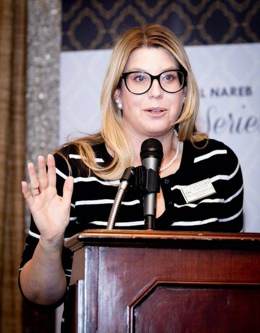 Melissa Fama-Flis, marketing director, Nevada, for Century Communities, moderates the NAREB event, the first in a three-part series on luxury real estate. (Tonya Harvey Las Vegas Business Press)