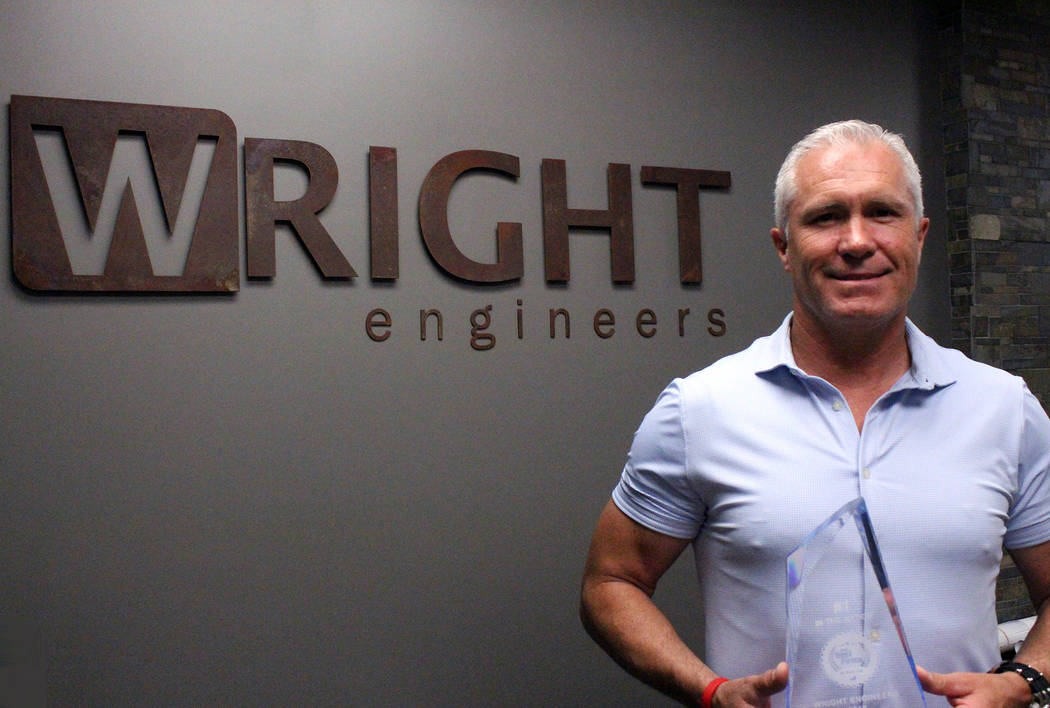 "Brent Wright, CEO and founder of Wright Engineers, holds an award for being named the 2018 ""Best Firm to Work For"" in the structural engineering category in the U.S. and Canada by Zweig Group. ..."
