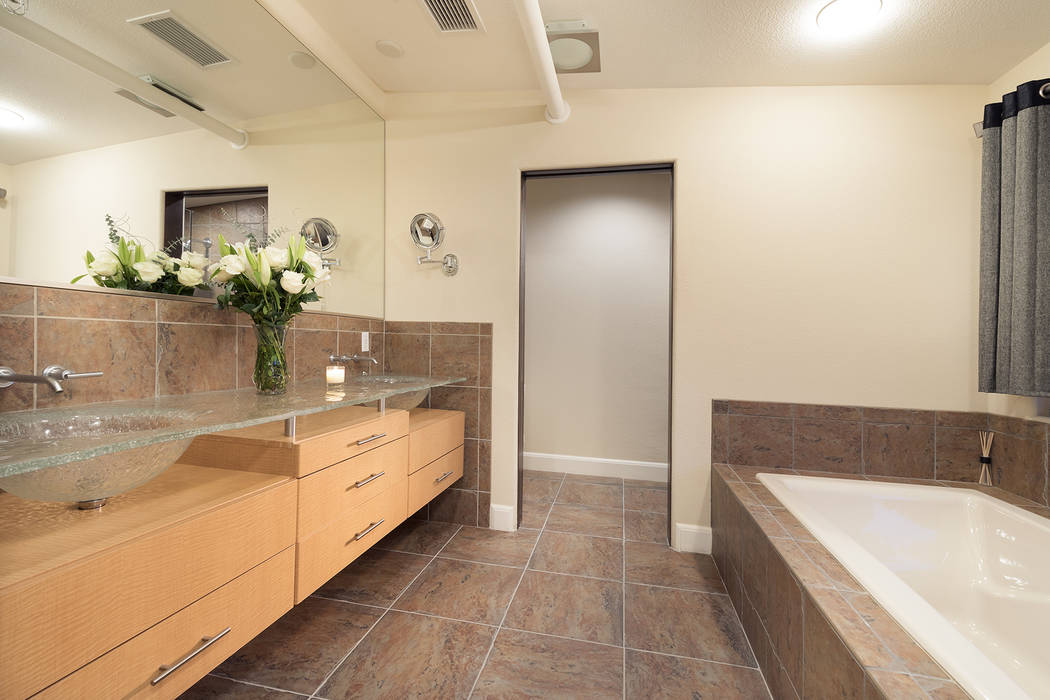 The C2 Lofts condo features a modern bath. (Christopher Homes)