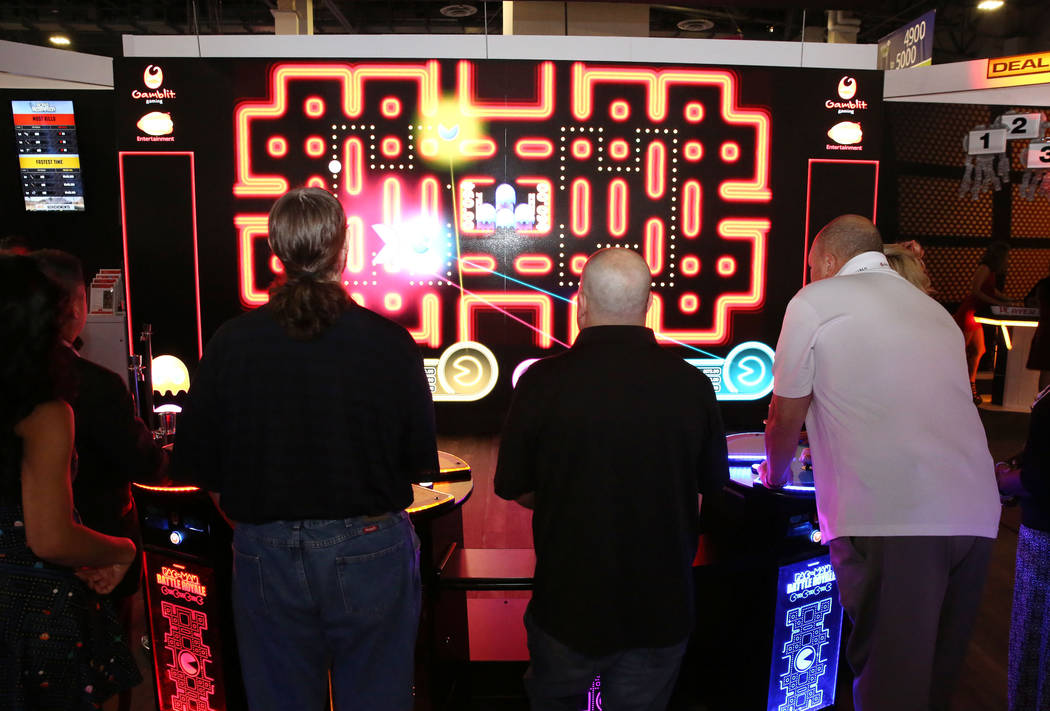 Global Gaming Expo attendees play Pac-Man Battle at the Gamblit Gaming booth at last year's event. This year's G2E kicks off Monday. (Bizuayehu Tesfaye Las Vegas Business Press)