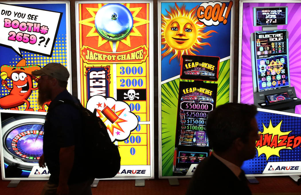 Global Gaming Expo attendees check out new technology at the 2017 convention. This year's event starts Monday, and promises to showcase even more technology. (Bizuayehu Tesfaye Las Vegas Business ...