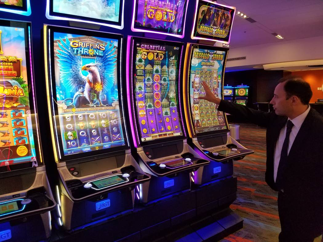 Nick Khin, IGT's chief commercial officer for gaming, checks out IGT's large format Celestial Towers of Gold slot machine. It was featured at this week's Global Gaming Expo. (Richard N. Velotta ...