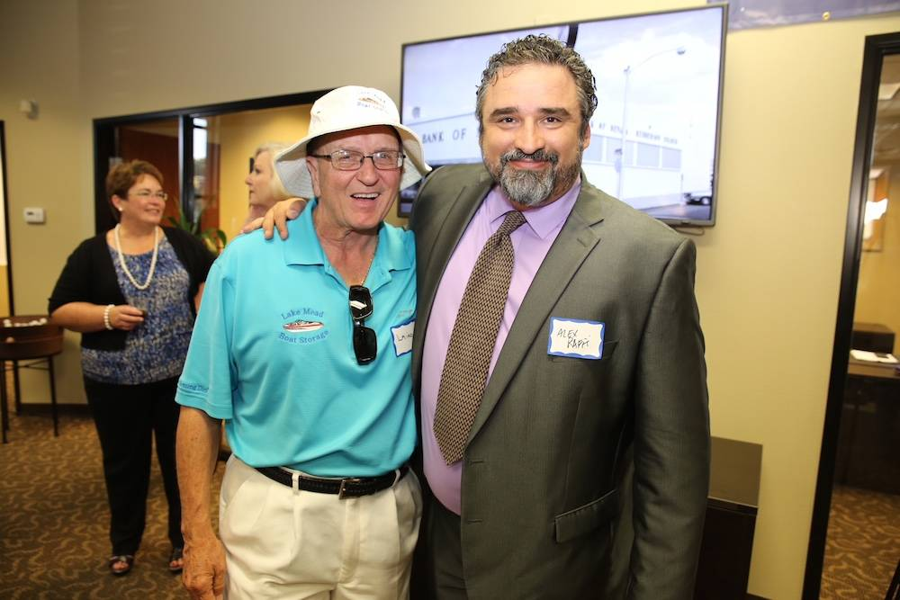 From left, the late Laird Noble Sanders and Alex Raffi, partner and creative director at Imagine Communications, at the grand opening of Valley Bank of Nevada's Henderson location. Sanders died ...