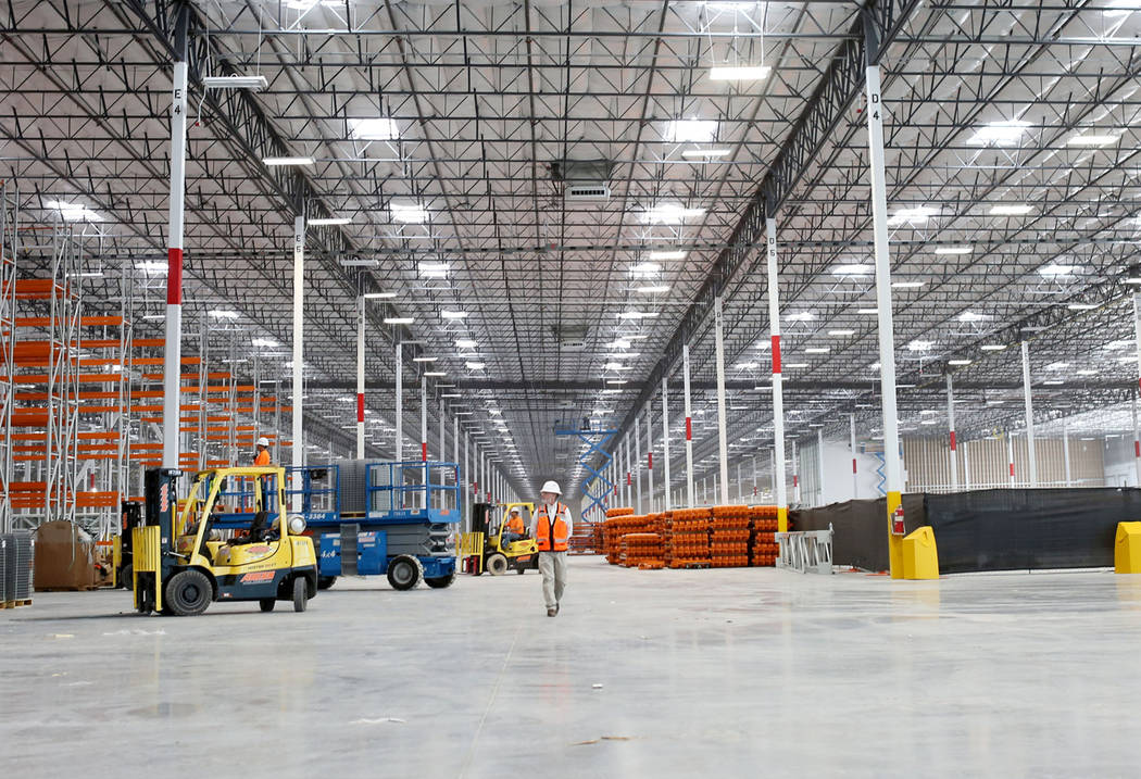 Earlier this year, a crew member oversees construction of the newest Amazon warehouse at Northgate Distribution Center in North Las Vegas. (Elizabeth Brumley/Las Vegas Business Press)