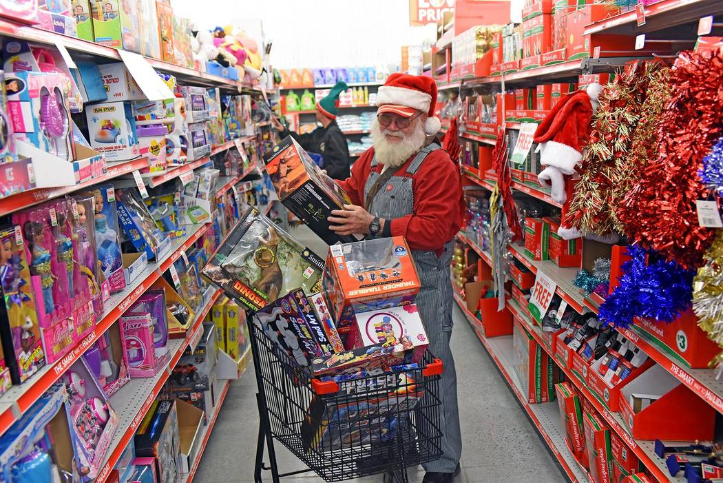 Santa (Fred Summers) and one of his elves shopping at the Family Dollar store in Beatty. Experts say Southern Nevada retailers will have a strong 2019. (Richard Stephens/Special to the Pahrump Va ...