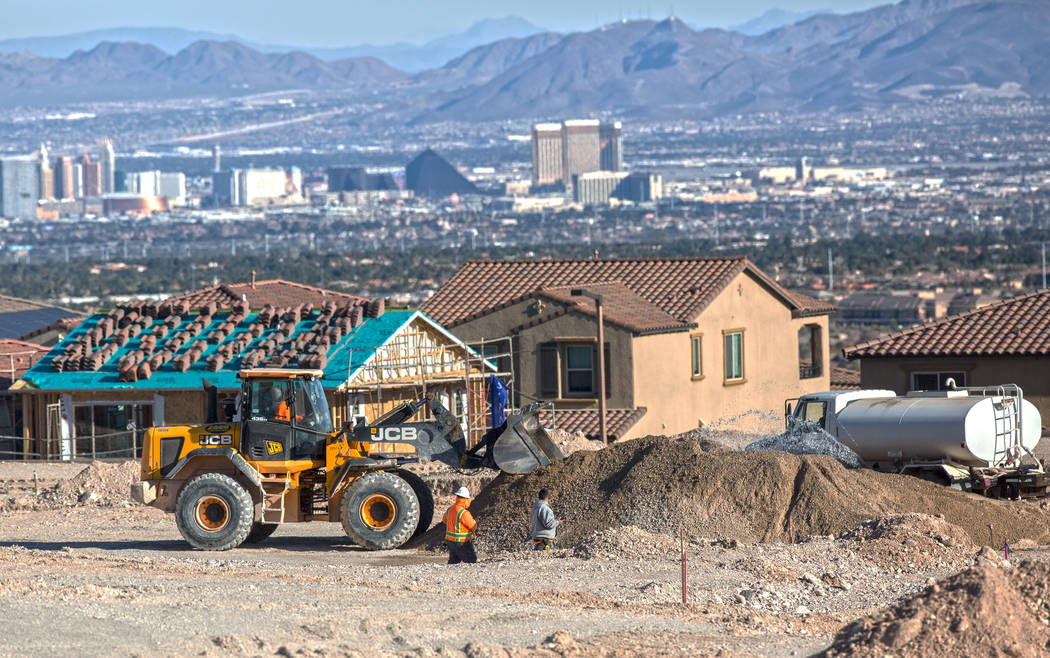Construction workers prep the area south of The Paseos in Summerlin for new home construction on Feb. 28, 2017. (Benjamin Hager/Las Vegas Business Press)